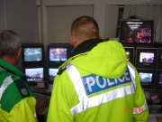 Police and Medics look at CCTV